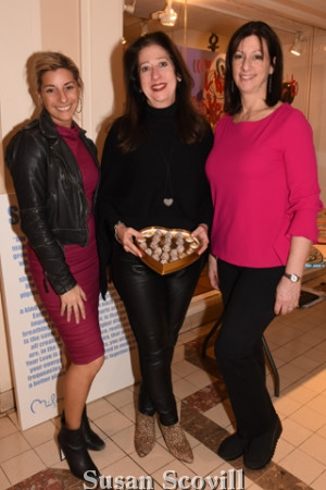 3. Anita Grossberg and Mary Dougherty offered chocolates to all who stopped by to view Perry Milou's work on display at the boutique! Palm Restaurant GM Julie Millard, paused for a photo during the meet and greet.