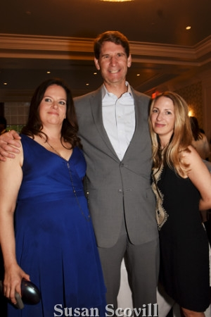 9. Melissa Bilash chatted with David and Vanessa Oliver during the reception.