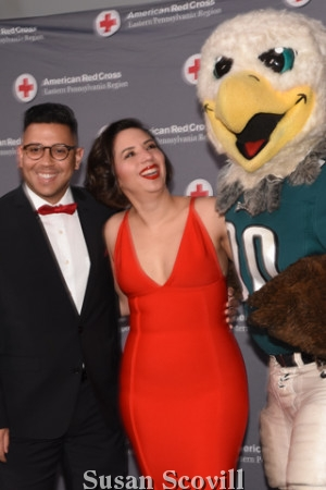 9. Clay Stiles and Rebecca Cruz said hello to Swoop, the Eagles mascot .