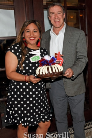 4. Kim Wright paused for a photo with Tom Burgoyne and her Bundt cake.
