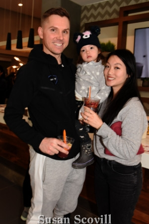 7. Geoff Bough and Cheryl Chow brought their infant daughter Madeline to the Pilates class.
