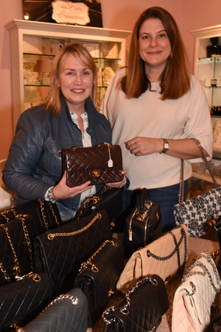 4. Virginia Funk and Lisa M.Stasse admired the collection of vintage bags for sale at the event.