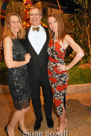 4. Sarah Claytor and her husband Brannan Claytor M.D. chatted with publicist Leslie Gross-Padilla during the preview event.