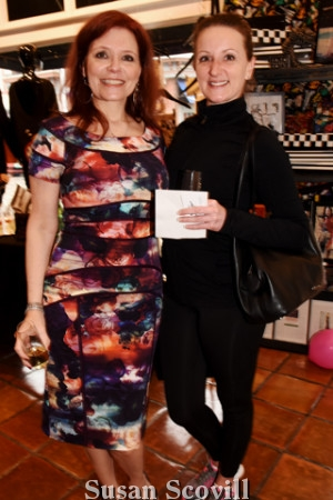 2. Cyndy Hazelton, wearing Nicole Miller, chatted with Rachel Grim.