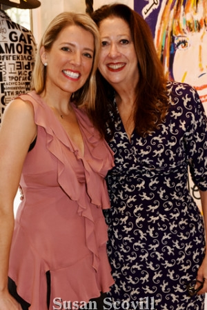 6. Laura Weathers and Mary Dougherty shared a moment at the event.