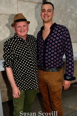 4. Sean Timmons wearing his polka dot-themed shirt chatted with Brian LaPann of Mole Street Artists.