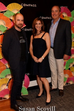 3. Gary Lacy, Sara Moyher and John Grady paused for a photo at the ''step and repeat''..