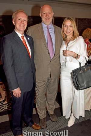 7. Mary and Rich Parente co-chaired the Ball on the Square Patron Party. They discussed the upcoming Ball on the Square auction items with Alasdair Nichol(center).
