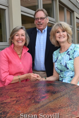 13. Laurie McGrath chatted with Mark and Patti Hallowell.