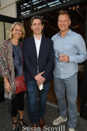 4. Kate Williams, CEO of 1% For the Planet and Jon Cociina chatted with Richie Graham during cocktails.