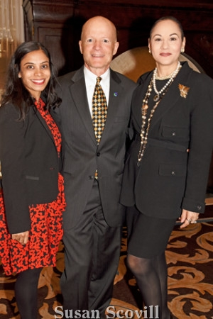 7. Monica Jindia of Commonwealth Land Title Company and John Finley of OceanFirst Bank paused for a photo with Lisa Silveri of the Agency Real Estate.