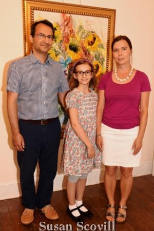 2. Lilla Tsvetkova (center) joined her parents Lyuben and Rumiana Tsvetkova for a photograph at the event.