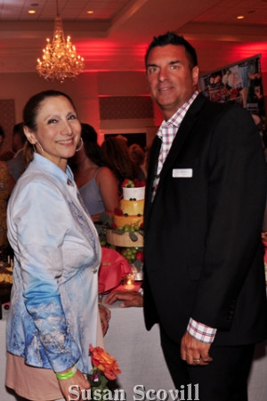 6. Conni McDonell chatted with John Serock at the event.