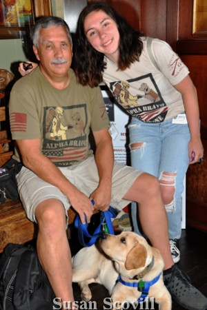 2. Paul and Emily Louck greeted attendees with service dog Louie.