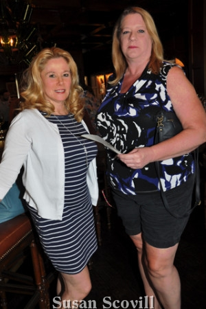 6. Michele Alifora and Carol Willis checked out the raffle prizes.