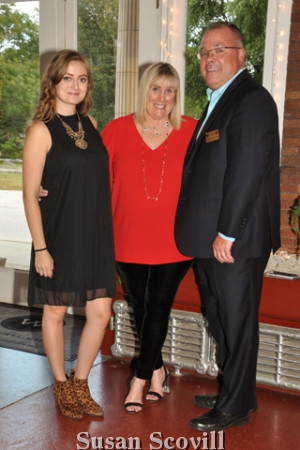 2. Joanie Sweeney, Debbie Cassidy and Tom Cavanaugh welcomed guests to the event.