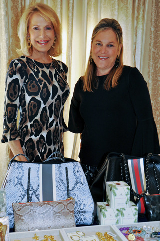 Sandra Yodesky and Maria Delany. owner of Louella's boutiques. paused for a photo before the fashion show began.