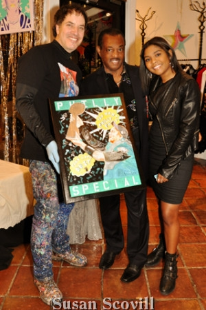 13. Artist Perry Milou paused for a photo with Robert Kool Bell and Jurnie Bell.