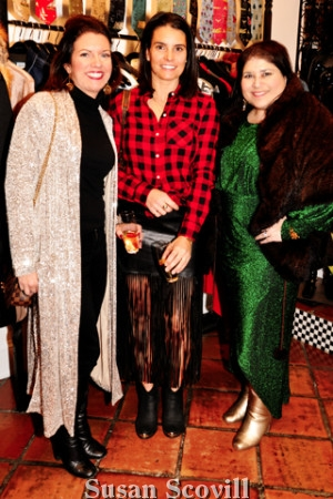 8. Nicole Klein and Stephanie Gambescia admired Jennifer Robinson's purchase - an elegant fur wrap,