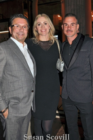 20. John Bolaris chatted with Andrea Desy Edrei and her husband Daniel Edrei at the Holiday Party.
