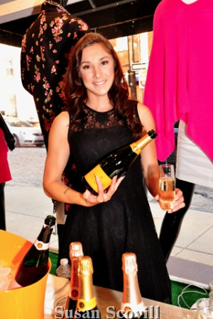 3. Stephanie Thomas served Veuve Cliquot champagne to the attendees.