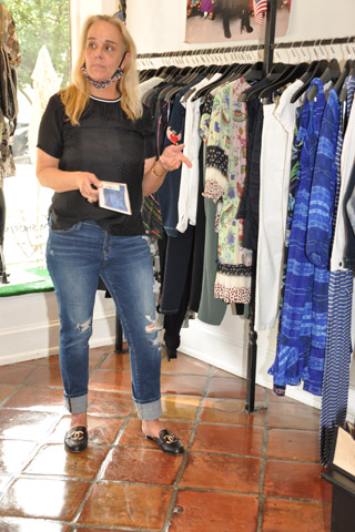 Jillian Dunn showwed attendees some of the new summer Nicole Mlller clothing