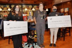 White Dog Cafe Glen Mills holds Alpha Bravo Canine and Brandywine Valley SPCA check presentation