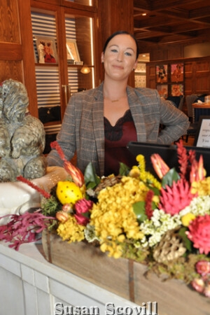White Dog Cafe manager Kathleen Malin at the reservation desk