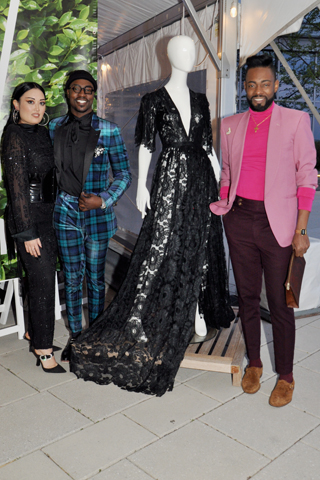 11. Ayumi Perry, Kree Williams were pictured with Philly Fashion Week's Prajje Oscar Jean-Baptiste, who designed all the dresses displayed on the mannequins in the reception area.