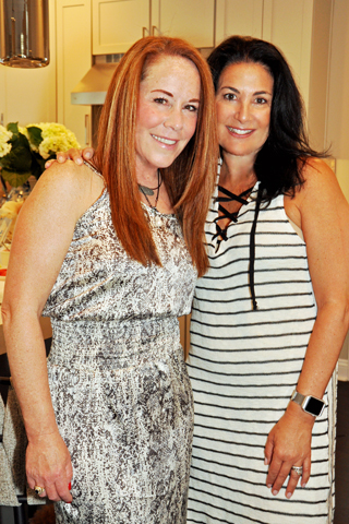 8. Randi Rubin chatted with Robin Swerdlow at the event.