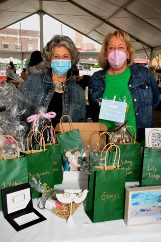 5. Saturday Club members Bernadette Nicholas and Kit Rothenberger manned this table of donated items