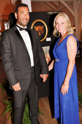13. Brian and Luiza Malloy examined the art exhibit and auction items that were available at the fundraiser.