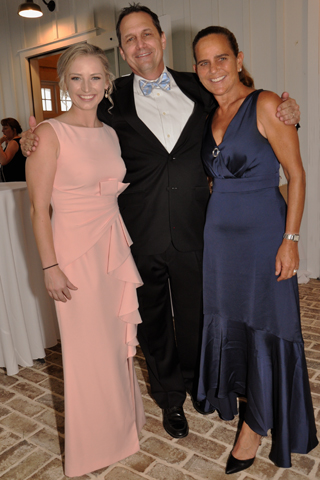 2. Mikaela Potrako and Jeff Parnell chatted with Caroline Moran during the fundraiser.