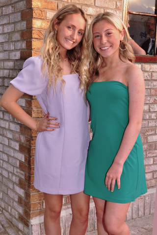 12. Erin Corbett and Grace Kane welcomed guests to the opening event.