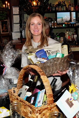 4. Ariel Mann was pictured with an abundance of raffle items.
