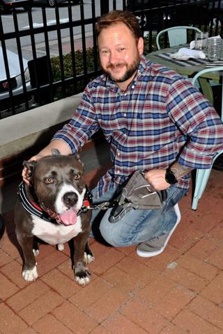 7. John Jordan sais hello to Honey Boy, an American Bull Dog.