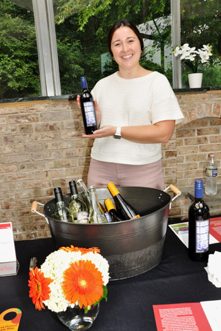 4. Emily Serkes event coordinator for Chaddsford Winery served samples of their wine to attendees.