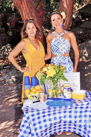 2. Sherry Mila and Bridget O'Brien welcomed guests to the event.